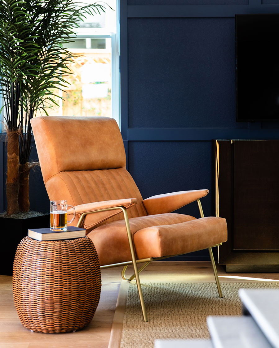 tan leather chair with gold frame and legs