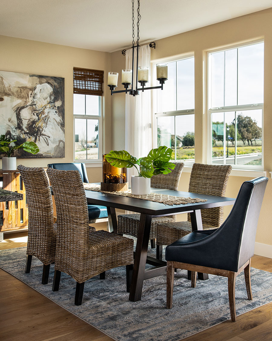 modern sun room dining table with wicker chairs