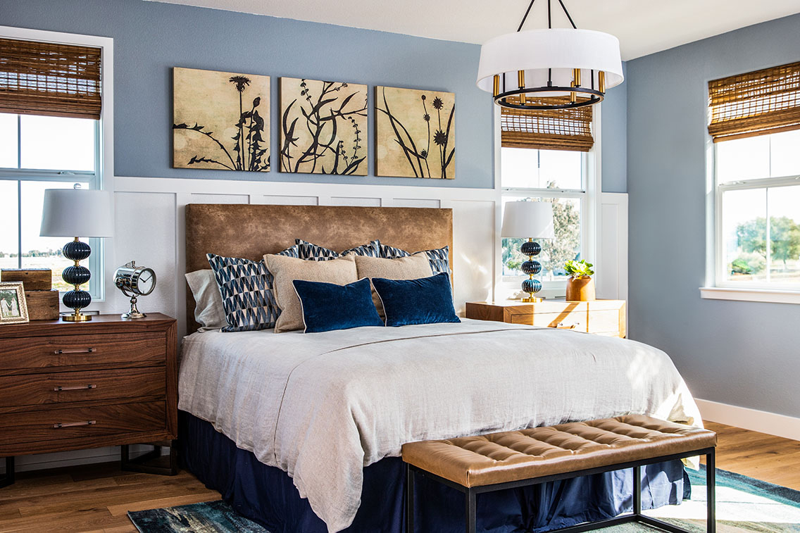 modern bedroom with wood bedroom set furniture and white and blue linen